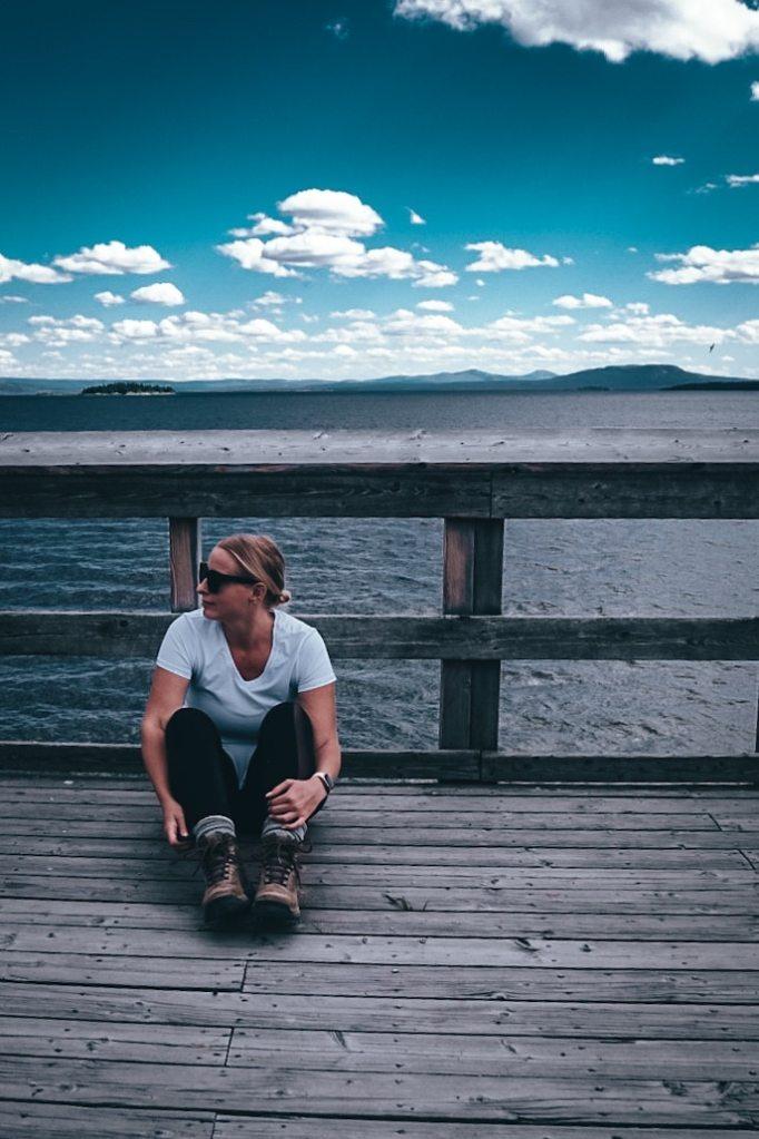 Woman sitting at Yellowstone Lake