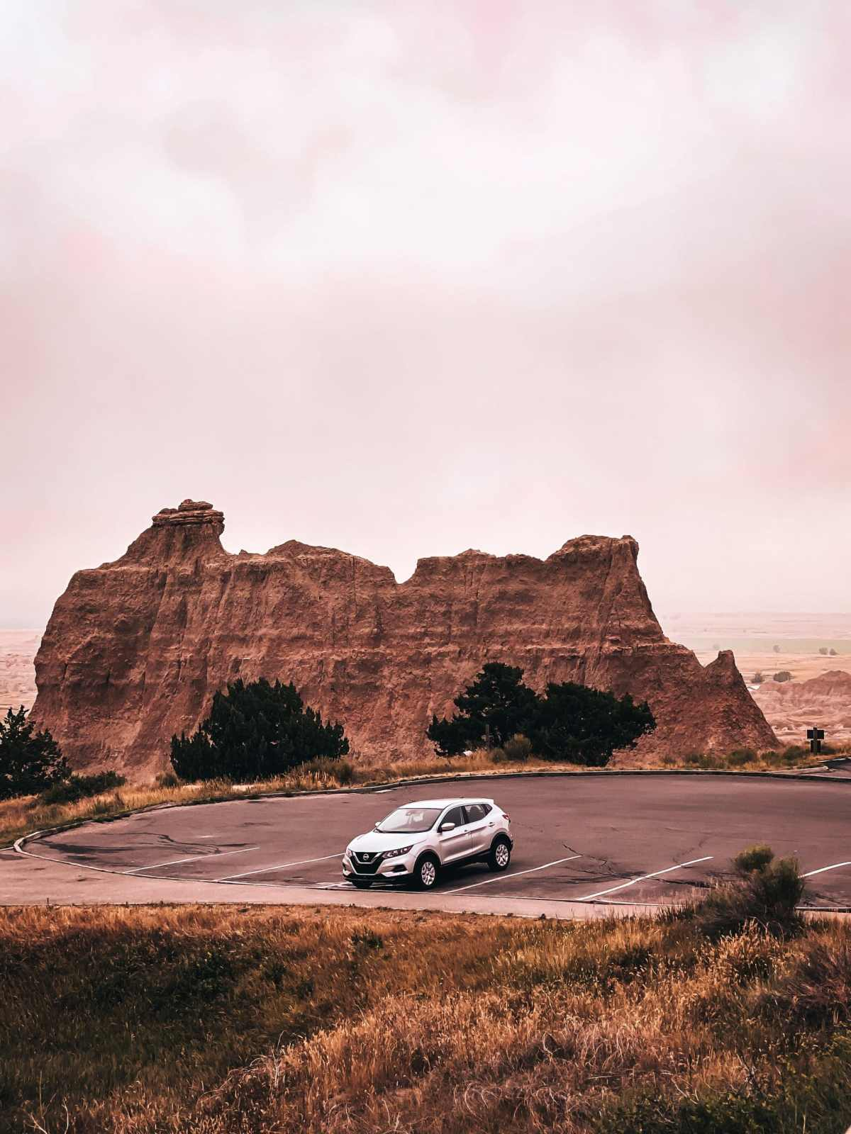 New Nissan Rogue sitting in parking lot in the Badlands National Park