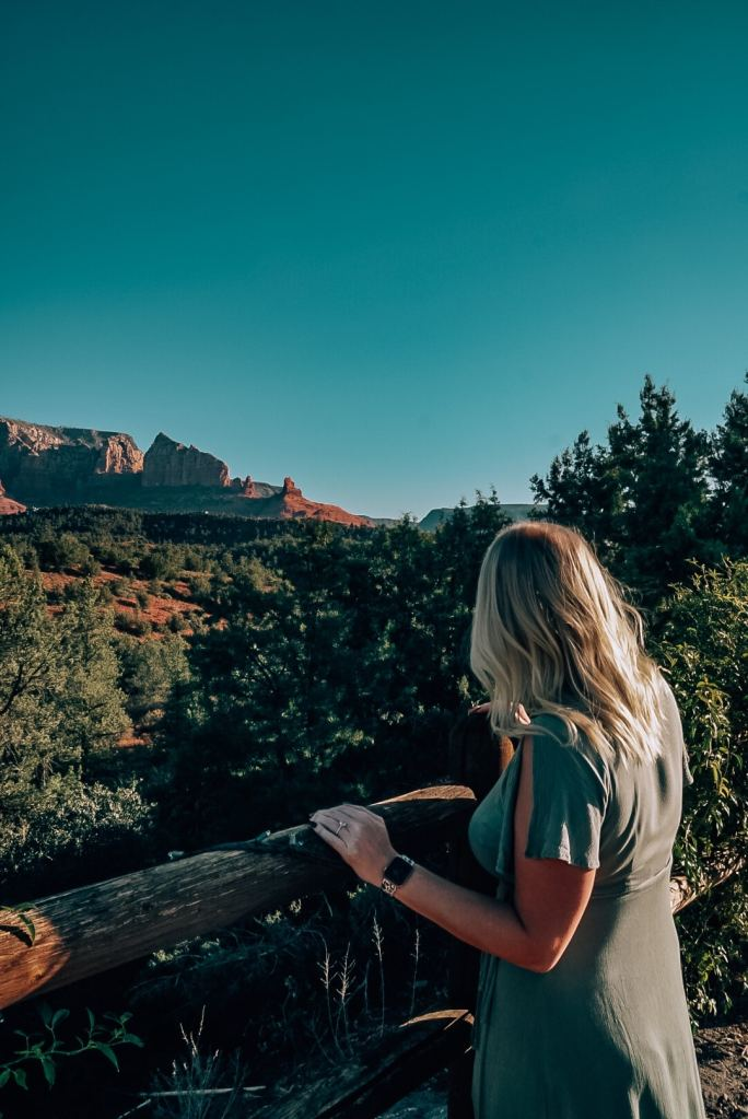 Woman looking at view from Mariposa in Sedona