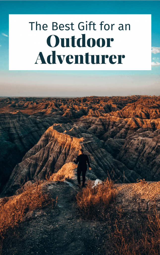 Pinterest cover for this article showing woman at Badlands National Park