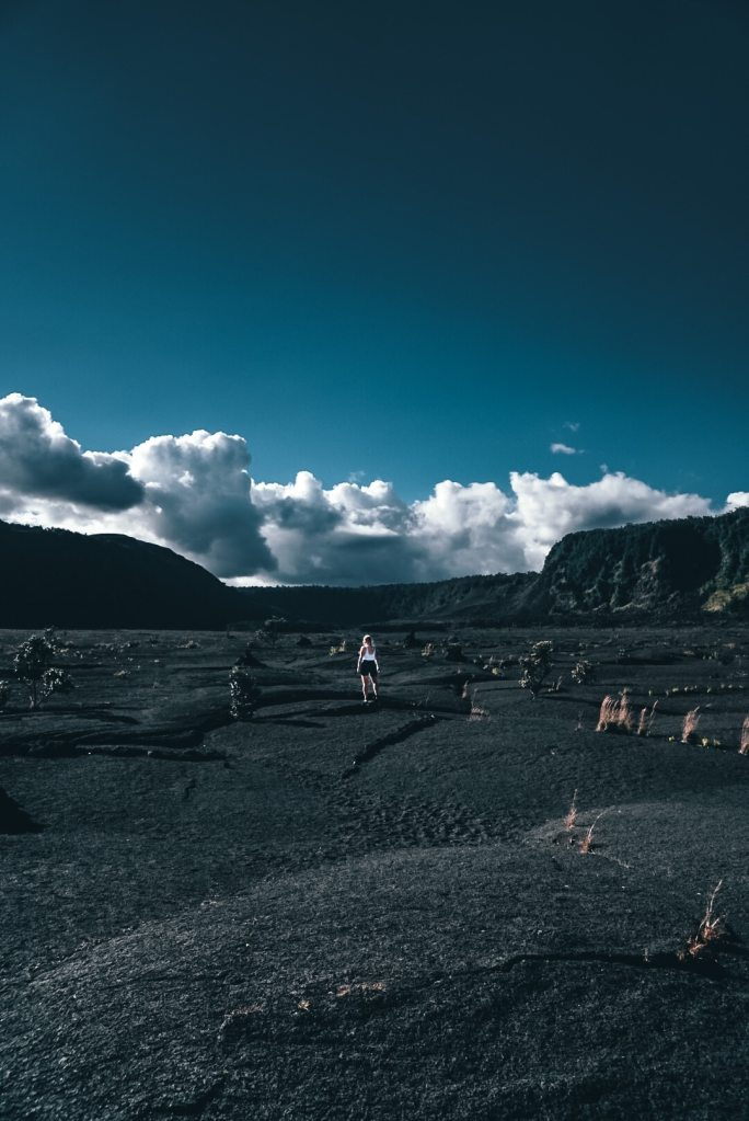 Woman standing in the middle of Kilauea Iki crater
