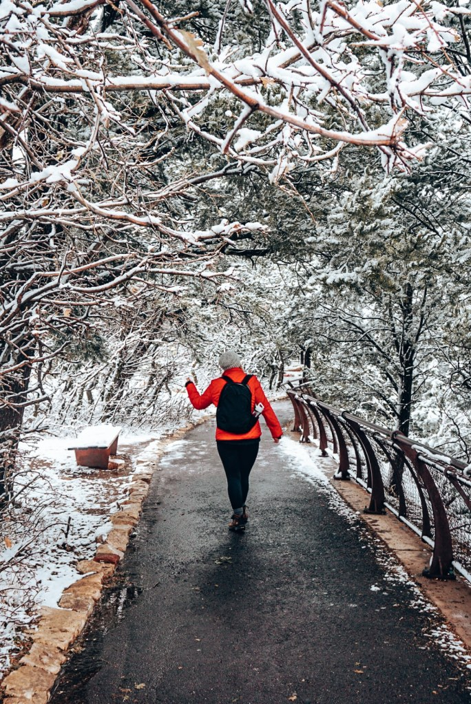 Woman walking through the walkways of the Grand Canyon in winter