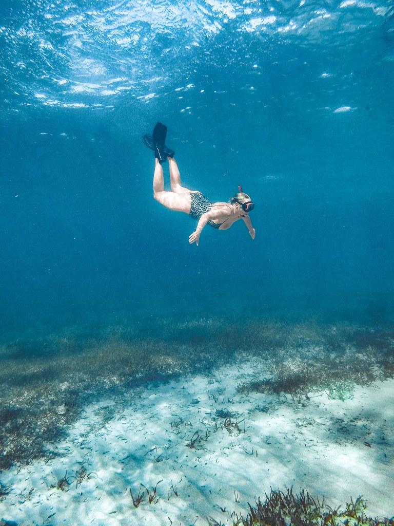 Woman underwater snorkeling