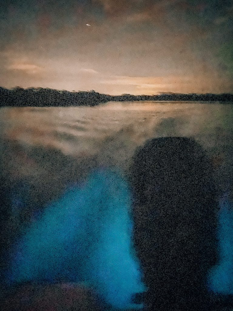 picture of the motor of a boat turning the bioluminescent bay of La Parguera bright blue