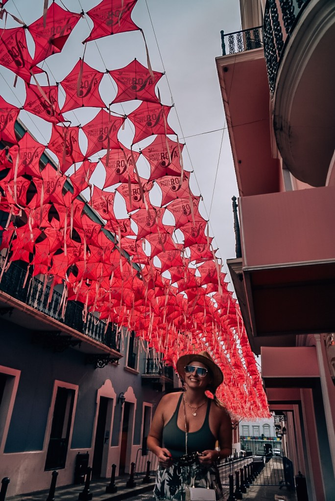 Woman standing in front of Fortaleza Street in Old San Juan
