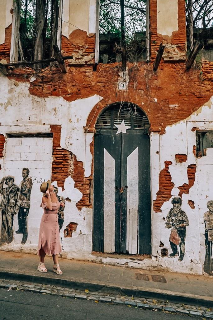 Woman standing in front of Puerto Rico Flag Door Historical Site