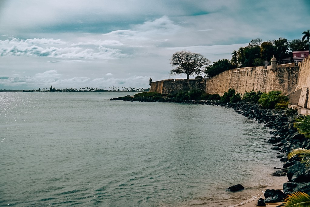 Beach coming up to the walls of Old San Juan