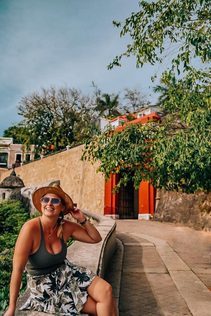 Woman sitting along the walls of Old San Juan