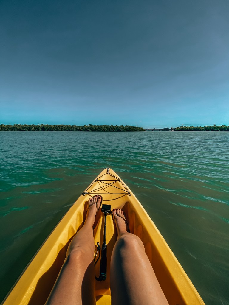 Woman sitting in a kayak looking out at the sea