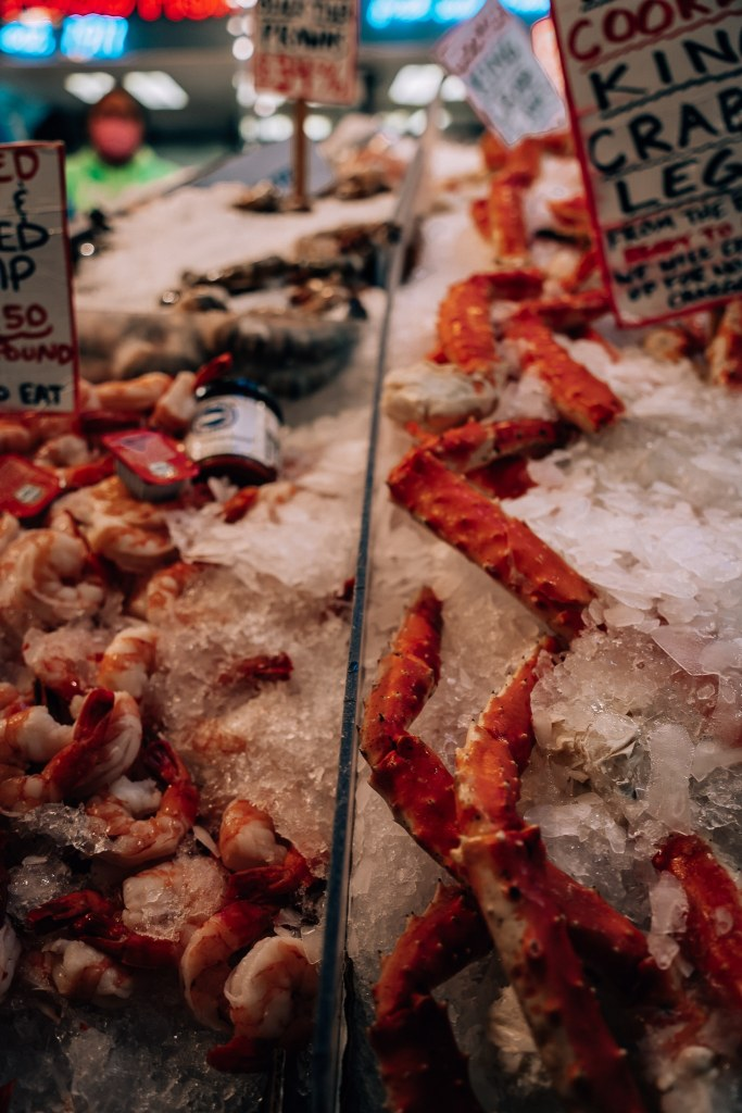 Up close shot of crab legs and shrimp for sale at Pike's Place Fish Market in Seattle, Washington